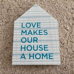 Love makes our house a home sign